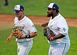 5 September 2008: Washington Nationals first baseman Dmitri Young (right), playing with the Vermont Lake Monsters during the final week of the New York-Penn League season, heads back to the dugout with infielder James Keithley (left) during a game against the Oneonta Tigers at Centennial Field in Burlington, Vermont. On a rehab assignment, Young was the first current Major League player to rehab with Vermont in its 15-year history. The Lake Monsters fell to the Tigers 10-4. Mandatory Photo Credit: Ed Wolfstein Photo