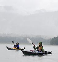 Jennifer Johnston, left, of Bothell and Lorna Johnston of Kirkland paddle across Baker Lake near Concrete, Wash., Fri., Sept., 28, 2007.