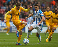 Preston North End's Tom Barkhuizen gets away from Huddersfield Town's Tommy Smith<br /> <br /> Photographer Alex Dodd/CameraSport<br /> <br /> The EFL Sky Bet Championship - Huddersfield Town v Preston North End - Friday 14th April 2016 - The John Smith's Stadium - Huddersfield<br /> <br /> World Copyright &copy; 2017 CameraSport. All rights reserved. 43 Linden Ave. Countesthorpe. Leicester. England. LE8 5PG - Tel: +44 (0) 116 277 4147 - admin@camerasport.com - www.camerasport.com