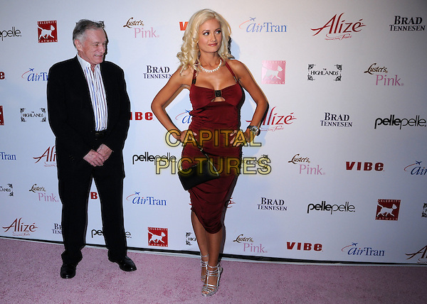 HUGH HEFNER & HOLLY MADISON .Celebrity Catwalk for Charity Benefit for National Animal Rescue at The Highlands Nightclub, Hollywood, California, USA..August 28th, 2008.full length red dress burgundy maroon black silver sandals shoes halterneck suit striped stripes shirt couple hands on hips .CAP/ADM/BP.©Byron Purvis/AdMedia/Capital Pictures.