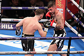 24th March 2018, O2 Arena, London, England; Matchroom Boxing, WBC Silver Heavyweight Title, Dillian Whyte versus Lucas Browne; Undercard fight between  Lewis Ritson versus Scott Cardle British Lightweight championship; Lewis Ritson and Scott Cardle trade blows in the centre of the ring