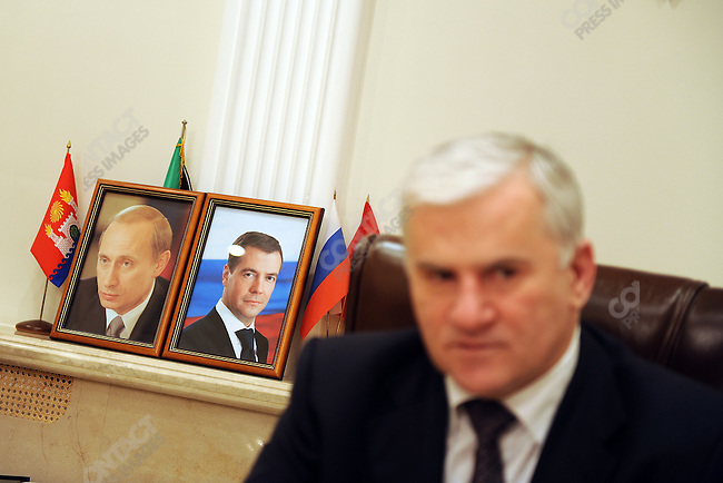 Said Amirov, the mayor of Mahachkala, in his office where the portraits of president Medvedev and prime minister Putin stood on the shelf. Mahachkala, Dagestan, January 25, 2010