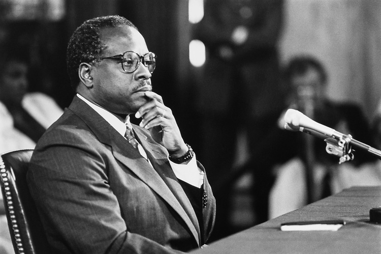 Clarence Thomas listening to Senate Judiciary Committee introduction statement in the Russell Building, on September 12, 1991. (Photo by Laura Patterson/CQ Roll Call)