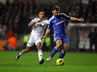 Pictured L-R: Scott Sinclair of Swansea challenged by Branislav Ivanovic of Chelsea. Tuesday, 31 January 2012<br />