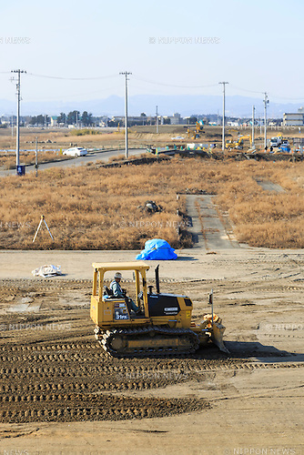 A bulldozers works in one of the areas affected by the 2011 Tohoku Earthquake and Tsunami in Natori on February 12, 2016, Miyagi Prefecture, Japan. <br /> A few weeks before of the fifth anniversary of 2011 Tohoku Earthquake and Tsunami, the Japanese government announced that the second half of the reconstruction work in the Tohoku area is expected to be concluded before the 2020 Tokyo Olympics begin. According to the official Reconstruction Agency's website approximately $250 billion were allocated to the first period (2011-2015) and $65 billion more have been set aside for a ''Reconstruction and Revitalisation Period'' starting from fiscal 2016. <br /> The Agency also reported that the number of evacuees has decreased from over 470,000 to about 180,000 in the 5 years since the disaster. According to the latest Japanese National Police Agency figures (published on February 10, 2016) 15,894 people died as a result of the earthquake and tsunami and 2,562 are still listed as missing; 6,152 people were injured, and 121,803 properties collapsed. <br /> Areas devastated by the earthquake and tsunami like Minamisanriku, Kesennuma, Onagawa, and Ishinomaki are in the process of recovery but reconstruction in parts of Fukushima will take much longer due to radiation contamination. (Photo by Rodrigo Reyes Marin/AFLO)