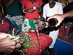 Kleren poured during Vodou ceremony in Cyvadier.