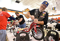 STAFF PHOTO BEN GOFF  @NWABenGoff -- 12/03/14 Pete Sturbleng of Rogers, with Rolling Thunder, joins the volunteer effort to assemble and quality check nearly 300 donated bicycles and tricycles in preparation for the NWA United Toys for Joy Christmas Toy Run at Pig Trail Harley-Davidson in Rogers on Wednesday Dec. 3, 2014. Hundreds of bikers will ride from Pig Trail Harley-Davidson to the Benton County Fairgrounds with the bicycles and toys on Dec. 13.