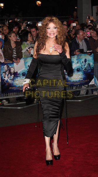 "LA TOYA JACKSON .Attending the UK film premiere of ""The Imaginarium Of Doctor Parnassus"" at the Empire Leicester Square cinema, London, England, UK, October 6th 2009..Latoya full length black lace-up sides corset dress platform patent christian louboutin shoes clutch bag silver diamond bracelets sleeves arm warmers cleavage hand .CAP/ROS.©Steve Ross/Capital Pictures"
