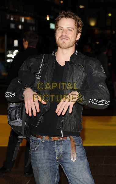 "ROBERT KAZINSKY.The world premiere of ""Watchmen"" Odeon Leicester Square, London, England..February 23rd, 2009.length black leather jacket jeans denim half 3/4 rob kazinski stubble facial hair hands funny face .CAP/CAN.©Can Nguyen/Capital Pictures."
