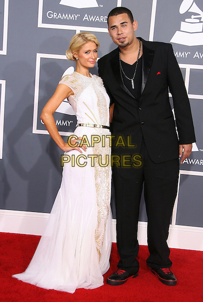 Paris Hilton & Afrojack (Nick van de Wall).The 54th Annual GRAMMY Awards held at the Staples Center, Los Angeles, California, USA..February 12th, 2012.full length white dress hand on hip lace silver belt side black suit couple .CAP/ADM.©AdMedia/Capital Pictures.