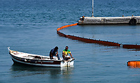Pictured: Specialist crew work to contain the oil spill that has reached the coast of Salamina, Greece<br /> Re: An oil spill off Salamina island&rsquo;s eastern coast is spreading and has become &ldquo;an environmental disaster&rdquo; according to local authorities in Greece.<br /> The spill was caused by the sinking of the Aghia Zoni II tanker, carrying 2,200 metric tons of fuel oil and 370 metric tons of marine gas oil on Saturday, southwest of the islet of Atalanti near Psytalleia. According to reports, the coastline stretching from Kinosoura to the Selinia community has &ldquo;turned black&rdquo; and authorities fear a new leak from the sunken ship.<br /> According to the island&rsquo;s mayor, Isidora Papathanasiou, the weather &ldquo;turned on Sunday afternoon and brought the oil spill to Salamina.&rdquo;