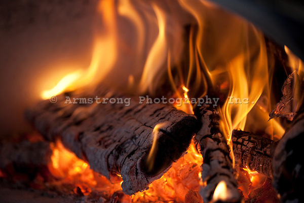 Close up of flaming logs and hot coals.