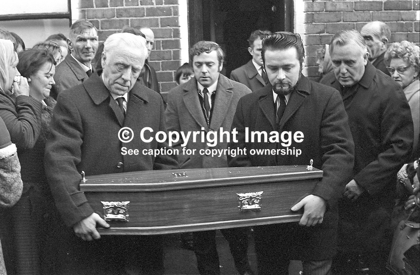 Funeral of 17 months old Tracey Munn, of Alloa Street,, Belfast, N Ireland, UK. Tracey was one of two children who died in a no warning Provisional IRA attack at a Shankill Road furniture store on 11th December 1971. The other child was 17 months old Colin Nicholl, of Colin Nicholl of Elimgrove Street, Belfast. The two funerals joined up in Clifton Park Avenue on the way to the cemetery. 197111410534a<br /> <br /> Copyright Image from Victor Patterson,<br /> 54 Dorchester Park, <br /> Belfast, UK, BT9 <br /> <br /> t1: +44 28 9066 1296 (from Rep of Ireland 048 90661296)<br /> t2: +44 28 9002 2446 (from Rep of Ireland 048 9002 2446)<br /> <br /> m: +44 7802 353836<br /> <br /> e: victorpatterson@me.com<br /> www.victorpatterson.com<br /> <br /> Please see my Terms and Conditions of Use at www.victorpatterson.com. It is IMPORTANT that you familiarise yourself with them.<br /> <br /> Images used on the Internet must be visibly watermarked i.e. &copy; Victor Patterson<br /> within the body of the image and copyright metadata must not be deleted. Images <br /> used on the Internet have a size restriction of 4kbs and will be chargeable at current<br />  NUJ rates unless agreed otherwise.<br /> <br /> This image is only available for the use of the download recipient i.e. television station, newspaper, magazine, book publisher, etc, and must not be passed on to any third <br /> party. It is also downloaded on condition that each and every usage is notified within 7 days to victorpatterson@me.com<br /> <br /> The right of Victor Patterson to be identified as the author is asserted in accordance with The Copyright Designs And Patents Act (1988). All moral rights are asserted.