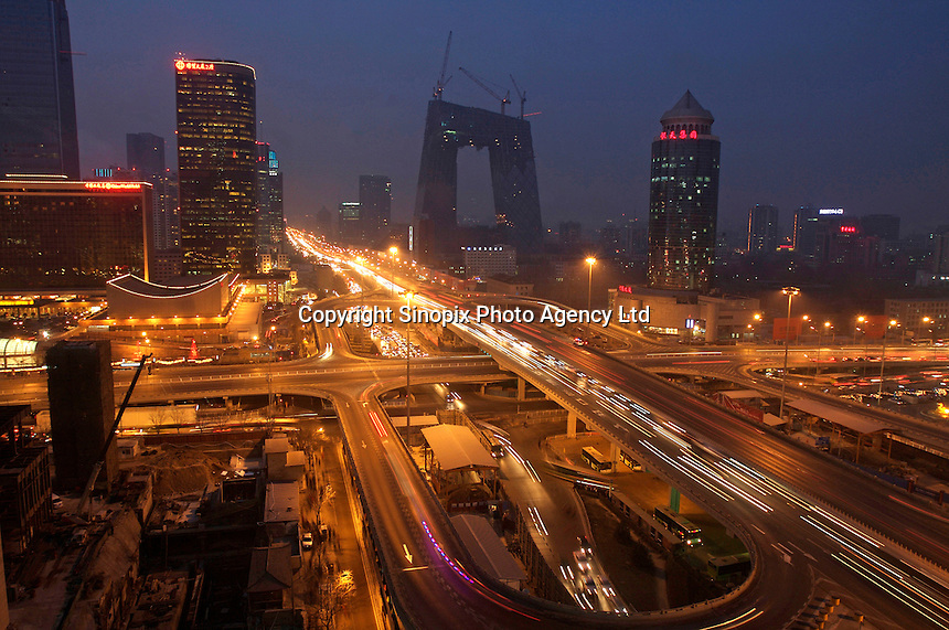 The central business district with CCTV building at the back in Beijing. At 54 stories tall and more than $600 million headquarters Ole Scheeren, the German architect-in-charge of the new CCTV said that it is about inovation rather than height..