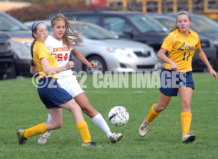 LOWER GWYNEDD, PA -  OCTOBER 23: Lower Moreland's Kaila Landau (3) chases after Gwynedd Mercy Academy's Margaret Jones (54) during a District One Class AA playoff game October 23, 2013 in Lower Gwynedd, Pennsylvania. Gwynedd Mercy Academy defeated Lower Moreland 5-1. (Photo by William Thomas Cain/Cain Images)