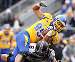BROOKINGS, SD - OCTOBER 5:  Cam Jones #85 from South Dakota State University is tripped up by D.J. Cameron #6 from Southern Illinois in the third quarter Saturday afternoon at Coughlin Alumni Stadium in Brookings. (Photo by Dave Eggen/Inertia)