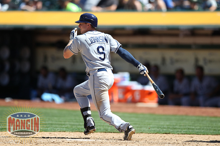 OAKLAND, CA - AUGUST 1:  Elliot Johnson #9 of the Tampa Bay Rays bats against the Oakland Athletics during the game at O.co Coliseum on Wednesday, August 1, 2012 in Oakland, California. Photo by Brad Mangin