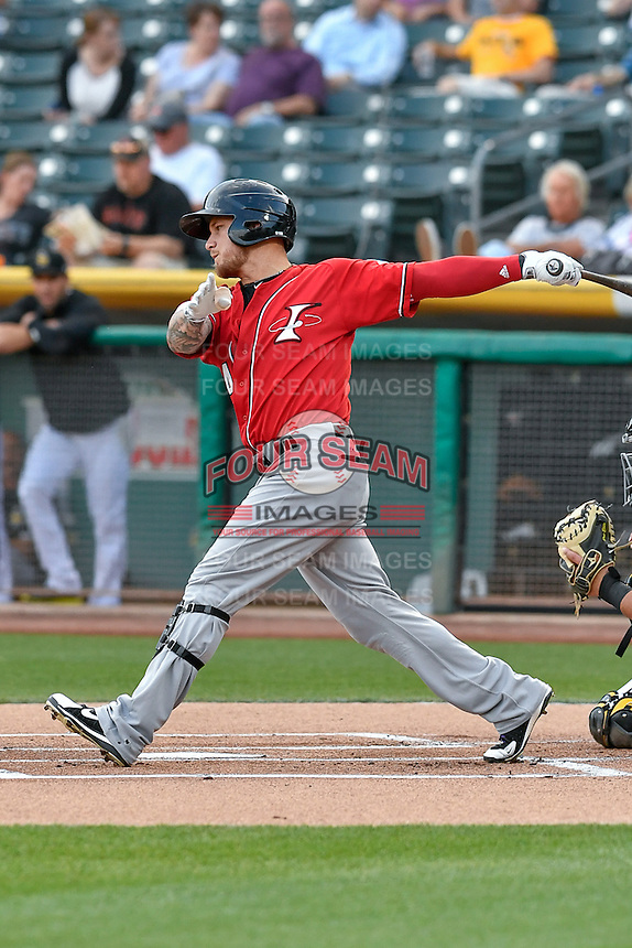 Brandon Barnes (4) of the Albuquerque Isotopes follows through on his swing against the Salt Lake Bees during the Pacific Coast League game at Smith's Ballpark on August 30, 2016 in Salt Lake City, Utah. The Bees defeated the Isotopes 3-2. (Stephen Smith/Four Seam Images)
