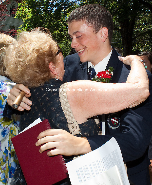 WASHINGTON, CT- MAY 24  2011-053112DA08-  TGraduate of The Gunnery in Washington Anthony Paul D'Elia receives a hug from his grandmother Shirley Falco after the commencement ceremony held at the First Congregational Church on Thursday..Darlene Douty Republican American