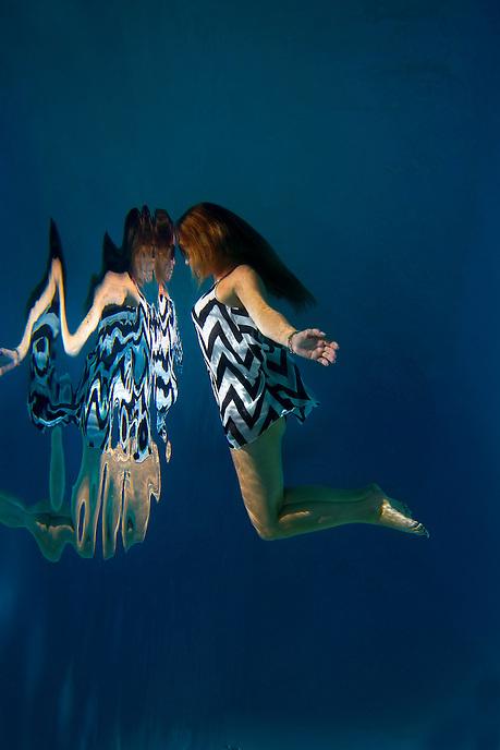 Underwater female fashion model San Diego, CA - Model released A female underwater fashion model.