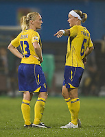 Sweden defender (6) Sara Thunebro talks with defender (13) Frida Ostberg. Sweden (SWE) tied Nigeria (NGA) 1-1 during a FIFA Women's World Cup China 2007 opening round Group B match at Chengdu Sports Center Stadium, Chengdu, China, on September 11, 2007.
