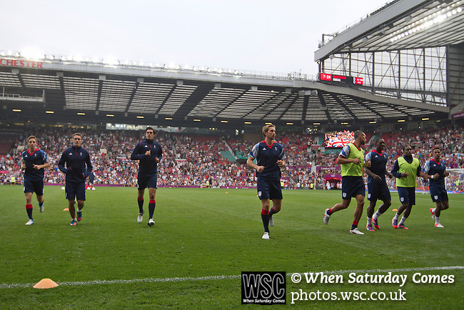 Uruguay 2 United Arab Emirates 1, Great Britain 1 Senegal 1, 26/07/2012. Old Trafford, Olympic Games. Great Britain football players going through their pre-match warm-up at Manchester United's Old Trafford stadium prior to the team's Men's Olympic Football tournament match at the venue. The double header of matches resulted in Uruguay defeating the United Arab Emirates by 2-1 while Great Britain and Senegal drew 1-1. Over 72,000 spectators attended the two Group A matches. Photo by Colin McPherson.