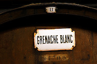 Grenache Blanc White Grenache rusty sign. Chateau de Nouvelles. Fitou. Languedoc. Wooden fermentation and storage tanks. France. Europe.