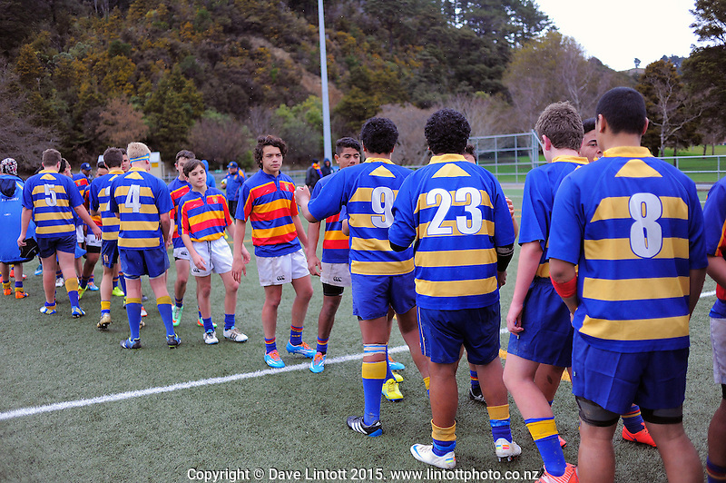 Action from the Hurricanes under-15 rugby tournament match between St Bernard's College (blue) and Tawa College (red yellow and blue hoops) at Maidstone Park Artificial Turf, Upper Hutt, Wellington, New Zealand on Tuesday,1 September 2015. Photo: Dave Lintott / lintottphoto.co.nz