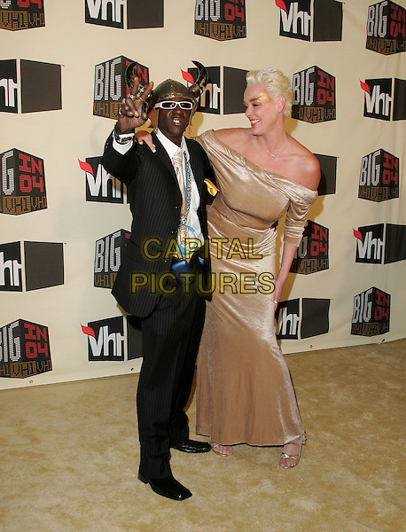 FLAVA FLAV & BRIGITTE NIELSEN.The VH1 Big in 04  Award Show held at The Shrine Auditorium in Los Angeles, California .December 1, 2004.full length, costume, necklaces, hat, viking, costume, jewellery, dress up, strapless, gesture, gold dress.www.capitalpictures.com.sales@capitalpictures.com.Supplied by Capital Pictures