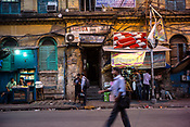 A pedestrians walks an old British Colonial building in BBD Bagh in Kolkata, West Bengal  on Thursday, May 25, 2017. Photographer: Sanjit Das