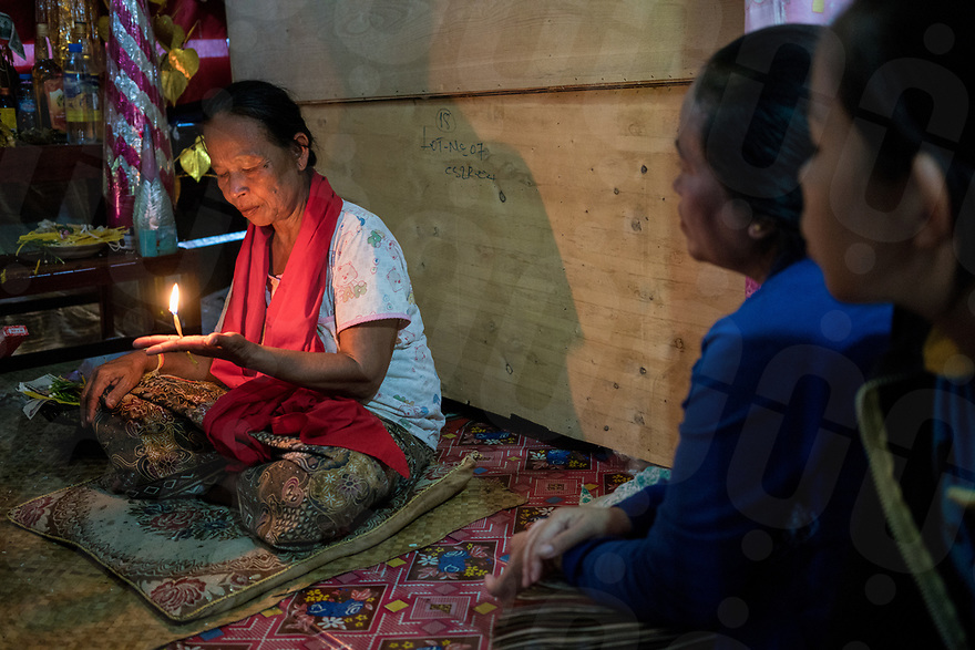 May 1st, 2017 - Nakasang (Laos). Besides running the biannual phi bob ceremony, Phoutan performs other medium duties like asking the spirit for advice or removing curses. © Thomas Cristofoletti / Ruom