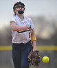 Julia Ruocchio #10 of Massapequa delivers to the plate during a non-league varsity softball game against host MacArthur High School on Tuesday, March 20, 2018. MacArthur won by a score of 3-0.