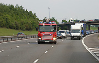 Fire Appliance attending an emergency call on the Motorway Warwickshire UK..This image may only be used to portray the subject in a positive manner..©shoutpictures.com..john@shoutpictures.com