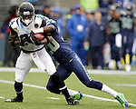 Jacksonville Jaguars  punt returner Will Blackmon (24) is wrapped up by Seattle Seahawks Jeremy Lane (20) during a first quarter punt at CenturyLink Field in Seattle, Washington on September 22, 2013. The Seahawks beat the Jaguars 45-17. ©2013. Jim Bryant Photo. ALL RIGHTS RESERVED.