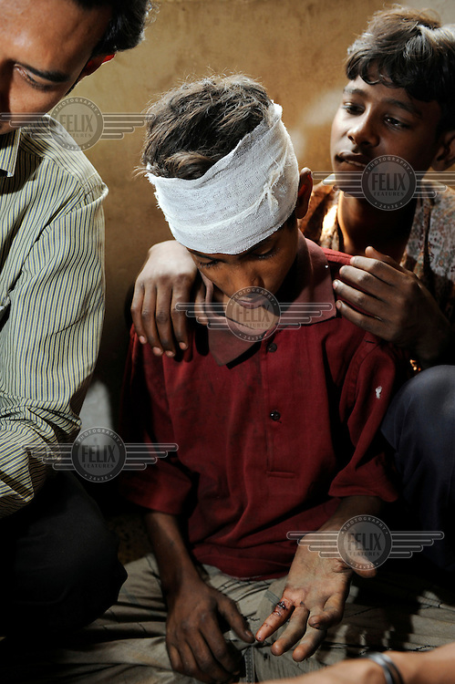 12 year old street kid Mamun was beaten on his head after he was unable to pay back a loan from a recycleable waste dealer. He receives first aid from staff at the shelter run by a local NGO that is supported by Dutch NGO  Terre des Hommes.