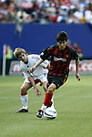 17 April 2004: Joselito Vaca (front) pulls away from Bobby Convey (15) during the first half. The MetroStars defeated DC United 3-2 at Giants Stadium in East Rutherford, NJ during a regular season Major League Soccer game..