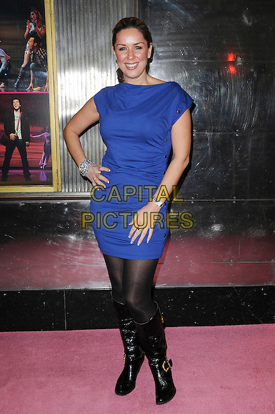 CLAIRE SWEENEY.The Gala Performance of 'Legally Blonde' at The Savoy Theatre, London, England..January 13th, 2010.full length black boots purple blue dress hand on hip ruched .CAP/CAS.©Bob Cass/Capital Pictures.