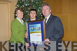 SPECIAL: Ethan Cronin from the Special Olympic who collected the Lee Strand - Kerry Garda Youth Acheivement Volountary Framed Certificate in Ballyroe Heights Hotel, Tra;lee on FRriday night helping Ethan to hold the certificate were, l-r: Kit Ryan and Jerry Duggan (Judges)............. . ............................... ..........
