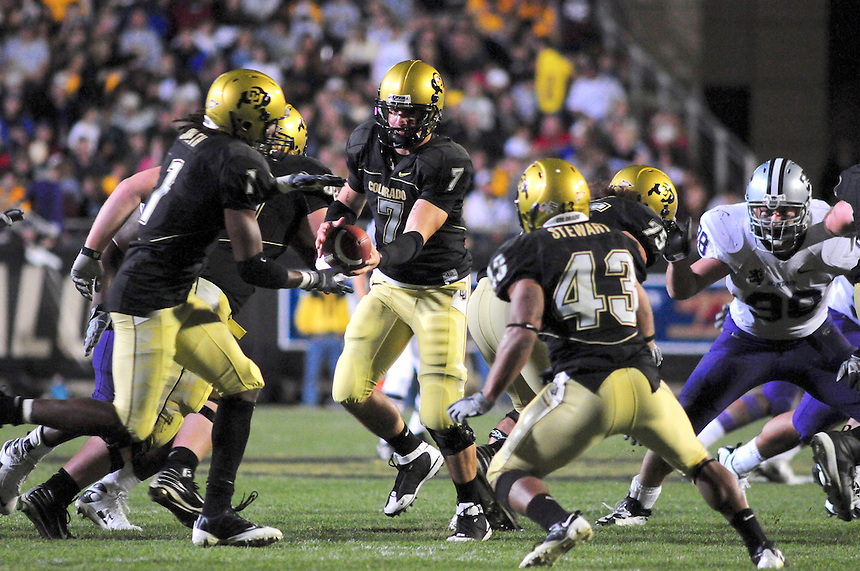 18 October 08: Colorado quarterback Cody Hawkins hands off to wide receiver Josh Smith (1) during a game against Kansas State. The Colorado Buffaloes defeated the Kansas State Wildcats 14-13 at Folsom Field in Boulder, Colorado.