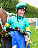 Oisin Murphy unsaddles Poet's Vanity in the winners enclosure after winning The European Bloodstock News EBF 'Lochsong' Fillies' Handicap,  trained by Andrew Balding during the Bathwick Tyres & EBF Race Day at Salisbury Racecourse on 6th September 2018