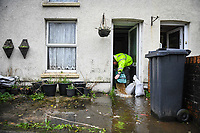 Flooding effected the villages of Aberdulais and Tonna in the Neath Valley after Storm Callum brought heavy rain and wind to the area cuasing the River Neath to reach bursting point. <br /> A man tries to empty his house of water at Canal Side, Tonna, Neath. Saturday 13 October 2018