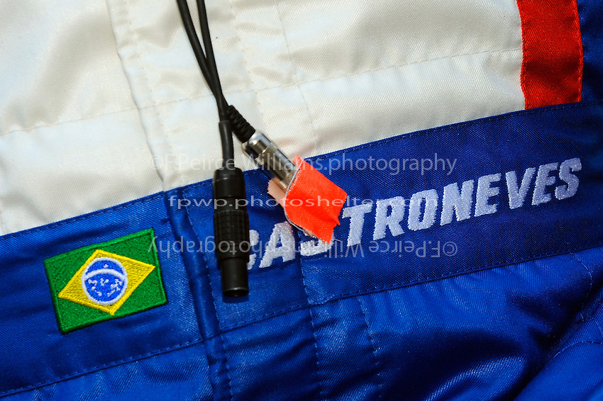 Radio plugs and detail on the uniform of Helio Castroneves (#3).