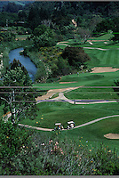 Aerial landscape of carts along a path in the the Carmel Valley Ranch golf course. Carmel Valley, California.