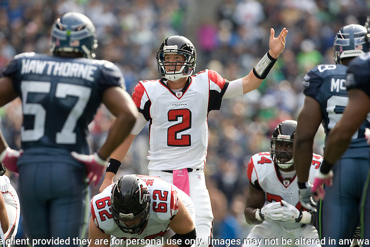 Atlanta Falcons quarterback Matt Ryan changes a play against the Seattle Seahawks in the third quarter at CenturyLink Field in Seattle, Washington on October 2, 2011. Ryan rushed for 26 yards, completed 28 of 42 passes for 291 yards and three for one touchdown in the Falcons 30-28 win over the Seahawks.  © 2011. Jm Bryant Photo. All Rights Reserved.