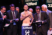 Jordan McCorry on the scales during a Weigh In at the BT Studios, Queen Elizabeth Olympic Park on 12th July 2019