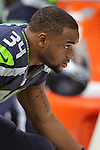 Seattle Seahawks  running back Thomas Rawls sits along the sidelines in their game against the Carolina Panthers  at CenturyLink Field in Seattle on October 18, 2015. The Panthers came from behind with 32 seconds remaining in the 4th Quarter to beat the Seahawks 27-23.  ©2015 Jim Bryant Photography. All Rights Reserved.