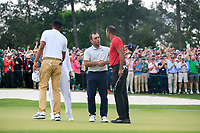 Tiger Woods (USA) celebrates with Francesco Molinari (ITA) after sinking his putt to win The 2019 Masters , Augusta National, Augusta, Georgia, USA. 14/04/2019.<br /> Picture Fran Caffrey / Golffile.ie<br /> <br /> All photo usage must carry mandatory copyright credit (© Golffile | Fran Caffrey)