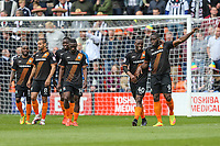 John Akinde of Barnet (right) celebrates with David Tutonda of Barnet (2nd right) after he scores the opening goal of the game during the Sky Bet League 2 match between Barnet and Grimsby Town at The Hive, London, England on 29 April 2017. Photo by David Horn.