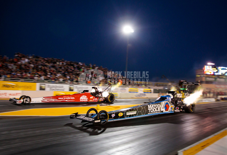 Jul 26, 2019; Sonoma, CA, USA; NHRA top fuel driver Antron Brown (near) racers alongside Doug Kalitta during qualifying for the Sonoma Nationals at Sonoma Raceway. Mandatory Credit: Mark J. Rebilas-USA TODAY Sports