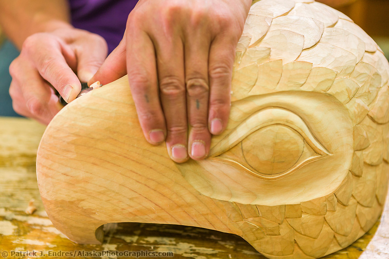 Tlingit Woodcarver, Tommy Joseph carves alder wood at the Sitka National Historic Park in the coastal town of Sitka, Alaska
